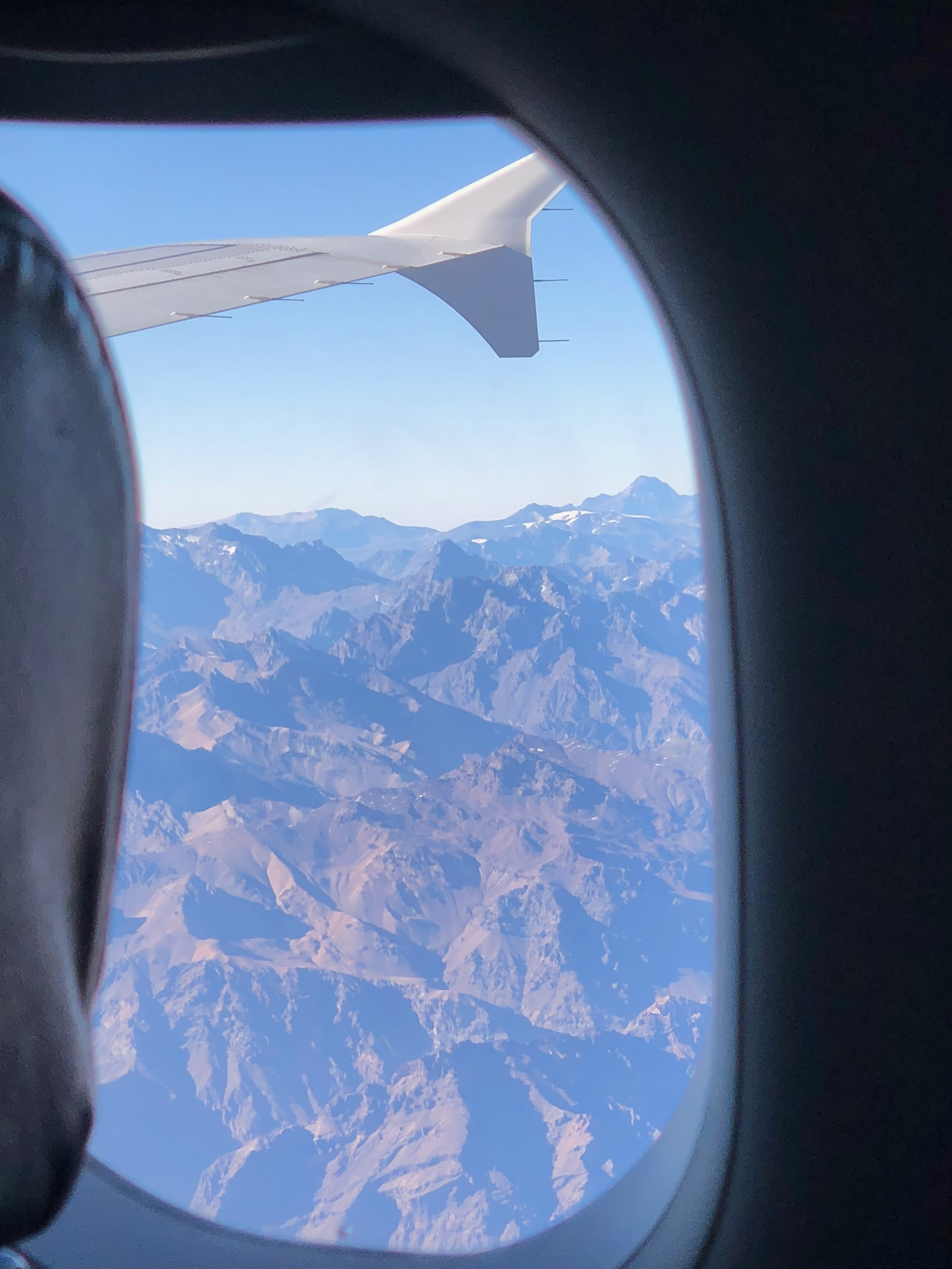 The view from the airplane window as we fly low over the jagged Andes mountains
