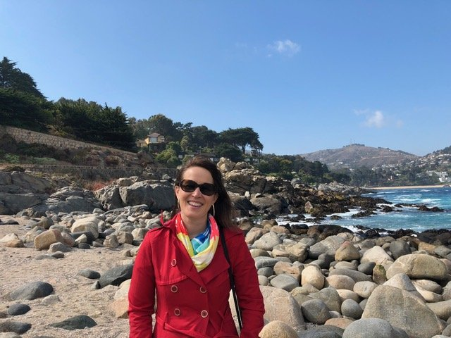Kathy from The Trip Takes Us posing in Zapallar, Chile