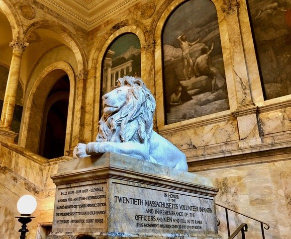 Lion sculpture in the grand staircase of Boston Public Library's McKim building.