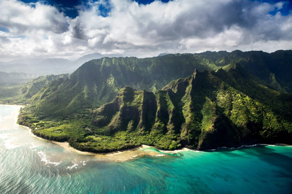 Aerial view of the rugged, verdant Napali coast in Kauai, Hawaii.