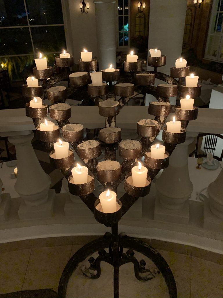 Traditional heart-shaped candle holder at the entrance to Maria Marie
