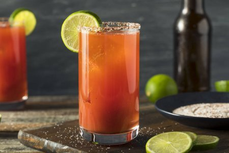 Photo of a Michelada (a Mexican drink made with beer, lime juice, hot sauce, spices, tomato juice and salt)