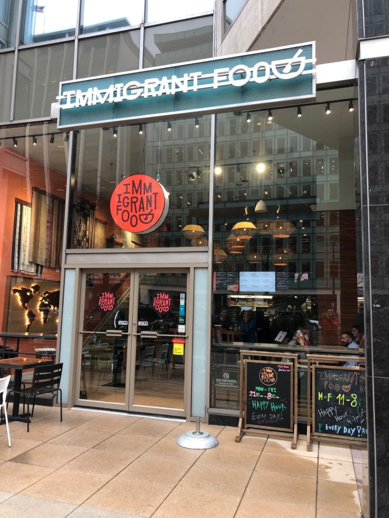 The storefront for Immigrant Food, a fast-casual restaurant with a social justice bent serving fusion bowls