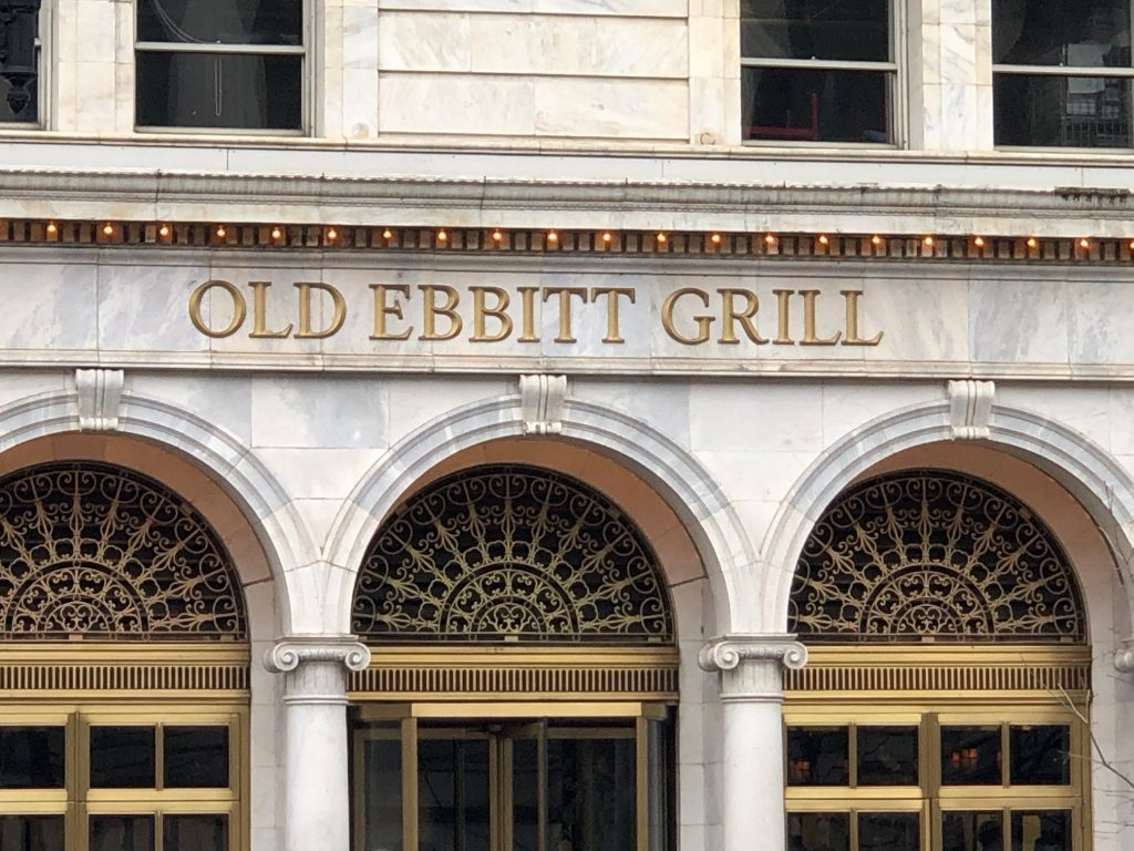 The stone facade of the Beaux-Arts building that is home to the Old Ebbitt Grill--one of the best places to eat near the National Mall