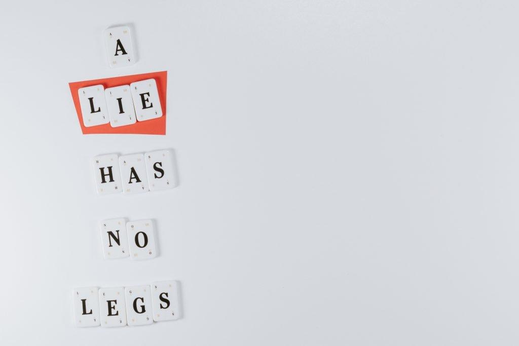 """White letter tiles reading """"A Lie Has No Legs"""""""