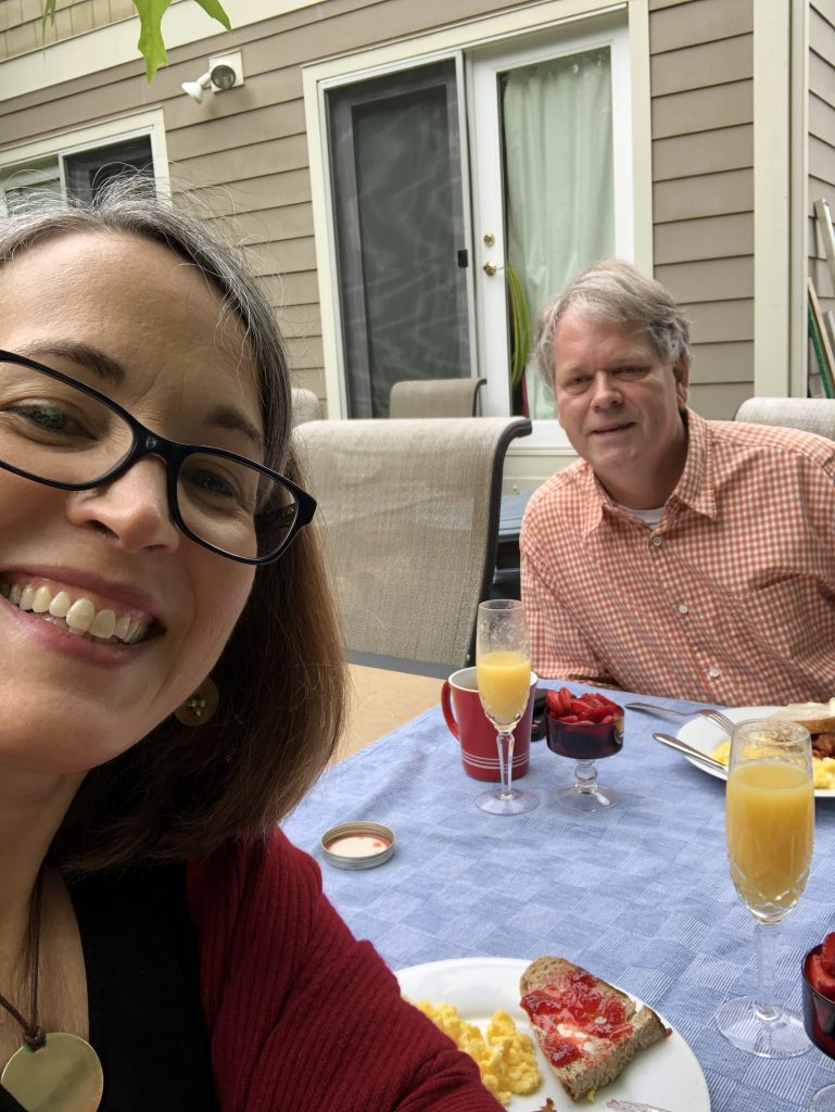 Jim Oliver and Kathy Forest enjoy a brunch date in the back yard during lockdown