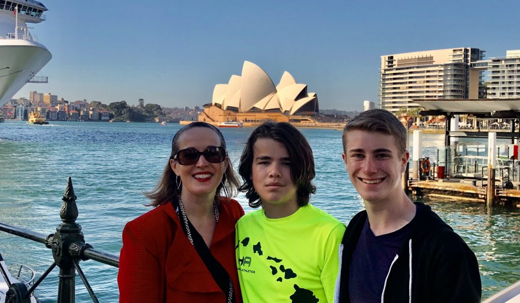 Kathy Forest and kids posing in front of the Sydney Opera House