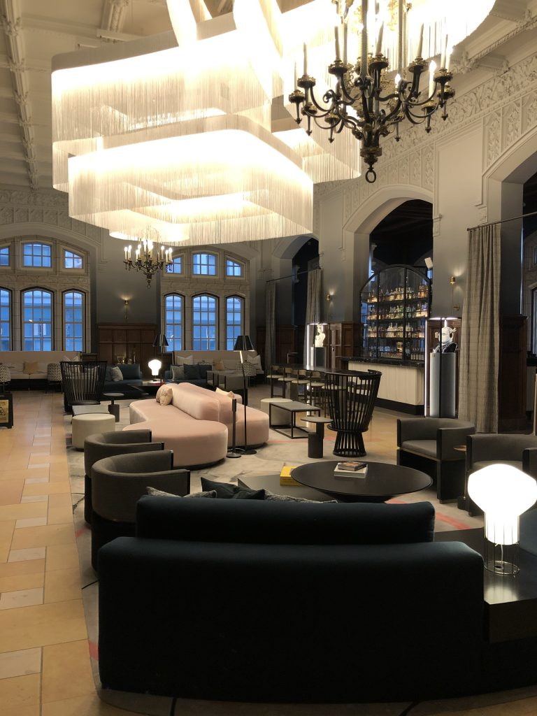 The stylish lobby bar and seating area with a variety of couches and chairs for enjoying your KC-themed beverage.
