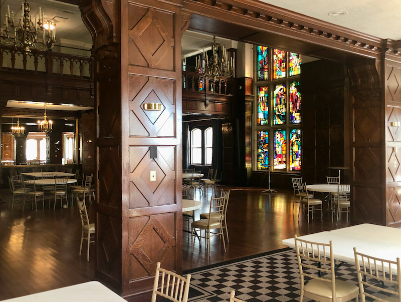 The Tudor Ballroom boasts a wall of medieval-themed stained glass panels